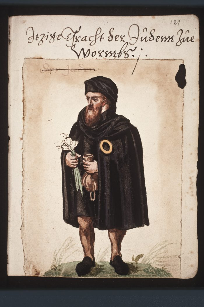 Garlic heads, money bag, and yellow badge as the insignias of a medieval Jew of the city of Worms (Wikicommons: Thesaurus Picturarum of Marcus zum Lamm, March 3, 1544 – February 13, 1606)